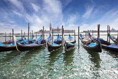 Venice. A sunset over the channel Grande and gondolas at the mooring Stock Images