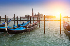 Venice. A sunset over the channel Grande and gondolas at the mooring Royalty Free Stock Photos