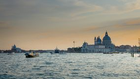 Venice sunset panorama :Santa Maria della Salute commonly, the Salute, Venice royalty free stock photo