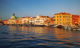 Venice / Sunset view of the river canal and old traditional venetian architecture Stock Image