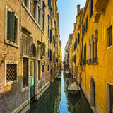 Venice sunset in water canal and traditional buildings. Italy Stock Photo