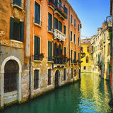 Venice sunset in water canal and traditional buildings. Italy Royalty Free Stock Photos
