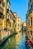 Venice sunset in water canal and traditional buildings. Italy Stock Photography