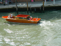 Venice taxi motorboat. Venice, Italy , 6 July 2015 - Wooden Venice taxi motorboat with passengers (water taxi) in Grand Canal in Venice , Italy, on 6 July 2015 royalty free stock photo