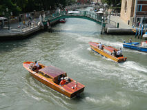 Venice taxi motorboat. Venice, Italy - 6 July 2015 - Wooden Venice taxi motorboat with passengers (water taxi) on Grand Canal , in Venice , Italy, on 6 July 2015 royalty free stock photography