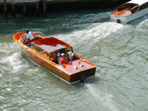 Venice taxi motorboat. Venice Italy - 6 JULY 2015 - Wooden Venice taxi motorboat with passengers (water taxi) in Grand Canal . on 6 July 2015 in Venice, Italy royalty free stock photography