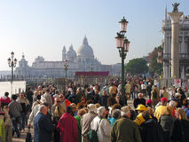 Venice: tourists near St Mark's square. Early evening in Venice: Piazza San Marco, canal, lampposts and crowd of tourists, taken in early evening Royalty Free Stock Photos