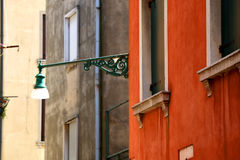 Venice. Traditional lamp on the picturesque street in Venice, Italy. Selective focus royalty free stock photography