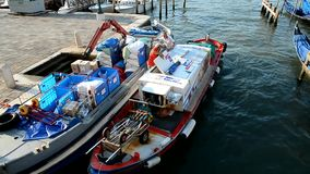Venice. Two freight motorboat at the pier stock footage