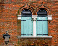 Venice, two pointed arch windows on a brick wall. Typical Venetian architecture named bifora: two arch pointed windows separated by a white marble column Stock Image