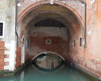 Venice, underpass. An underpass reflected in the waters of Grand Canal, detail, Venice, Italy Stock Photo