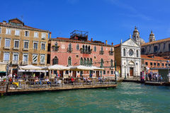 Venice urban life. VENICE, ITALY - SEPT 24, 2014: View on the Venice seafront at morning. Tourists from all the world enjoy the historical city of Venezia in Stock Photos