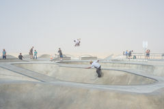 Venice, US-October 5, 2014: skateboarders on a misty morning at Royalty Free Stock Photo