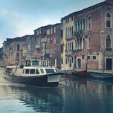 Venice Vaporetto On Quiet Canal. Venice Waterbus Transport With Colorful Historic Buildings Stock Images