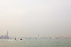 Venice, The Venetian Lagoon with a boat stock photo