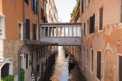 Venice, Veneto, Italy June 20, 2017. . Very narrow channel. A typical alley of the old part of the island of Venice. Royalty Free Stock Photos