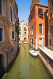 Venice, Veneto, Italy. Very narrow channel. A typical alley of the old part of the island of Venice. Stock Photography