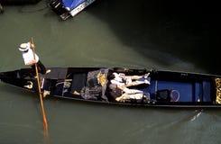 Venice. Venezia - Venice lagoon, gondola with tourists Stock Image