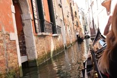 Venice view from Channel Italy. The classical Venetian boat is the gondola, although it is now mostly used for tourists. There are approximately 400 licensed Royalty Free Stock Photo