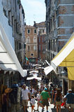 Venice view from famous Rialto Bridge on venetian typical shops street full of tourists, sunny day, Venice Royalty Free Stock Image
