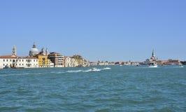 Venice. A view of the island of Dorsodoro in Venice taken from the island of Giudecca across the Giudecca Canal. The iconic Campanile di San Marco Saint Mark`s royalty free stock photos