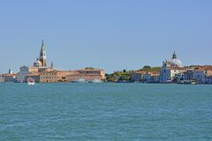 Venice. A view of the island of Giudecca in Venice taken from the island of Giudecca. The church of San Giorgio Maggiore can be seen on left, and Zitelle on the stock photo