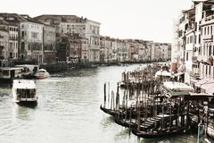 Venice in vintage hues. Beautiful Venetian cityscape from Ponte di Rialto bridge in vintage hues stock photography