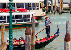 Venice. Walking on the gondola. Italy, Venice - 25 May, 2015: Venice. A gondola ride along the canals of Venice. The most popular tourist attraction royalty free stock photos