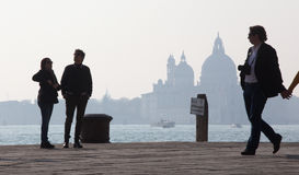 Venice - Walking on the waterfront and silhouette of Santa Maria della Salute church. Stock Images