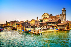 Venice, water canal, bridge and gondolas or gondole depot. Italy. Venice, water canal, bridge and gondolas or gondole depot on sunset. Italy, Europe royalty free stock image