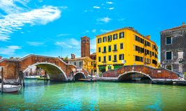 Venice, water canal and double bridge in Cannaregio. Italy. Venice, water canal and double bridge in Cannaregio. Italy Europe Stock Image