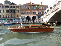 Venice Water Taxi at the Bridge Stock Photography