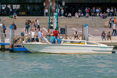 Venice. Water Taxi at the pier Santa Lucia Station in Venice. Stock Photos