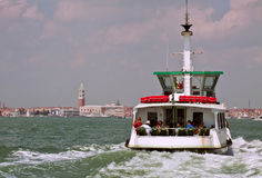 Venice-Waterbus full of tourists to S.Marco square Stock Images
