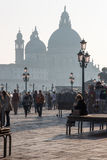 Venice - Waterfront for Doge palace and Santa Maria della Salute church in evening light. VENICE, ITALY - MARCH 14, 2014: Waterfront for Doge palace and Santa stock images