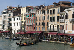 Venice waterfront with gondola near Rialto Royalty Free Stock Photography
