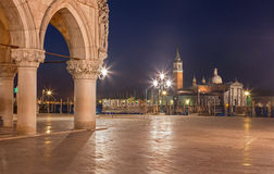 Venice - Waterfront of Saint Mark square and column of Doge palace and San Giorgio Maggiore church in background Royalty Free Stock Images