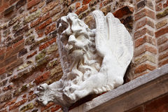 Venice winged lion as a monster. Old marble sculpture outside Santa Margherita Church in Venice (17th century Royalty Free Stock Image