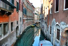 Venicean architecture and a lot of gondolas Royalty Free Stock Photo