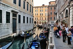 Venicean architecture and a lot of gondolas Stock Photography