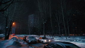 .vening snowy road in the city, lit by light of lanterns stock video