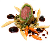 Venison. Fillet of venison in a crust of bread fried mushrooms Stock Photography