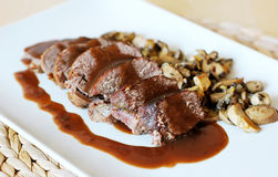 Venison. With wine rose sauce and mushrooms Royalty Free Stock Photo