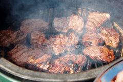 Venison being fried on grill. With a lot of aromatic smoke Stock Images