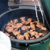 Venison being fried on grill. At outdoor kitchen Royalty Free Stock Image
