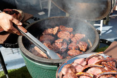 Venison being fried on grill. At outdoor kitchen Royalty Free Stock Photography