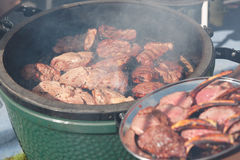 Venison being fried on grill. Outdoors Stock Photography