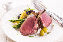 Venison Carree. With green asparagus mashed potatoes on a plate Stock Photo