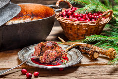 Venison with cranberry sauce and rosemary Royalty Free Stock Photography