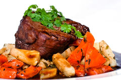Venison dish. Venison steak with carrot and mushrooms stock photo